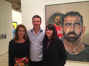 Julie Fison, Archibald 2014 finalist Alan Jones and Archibald 2014 winner Fiona Lowry with Jones' portrait fo Adam Goodes
