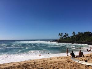Surfers at Waimea Bay