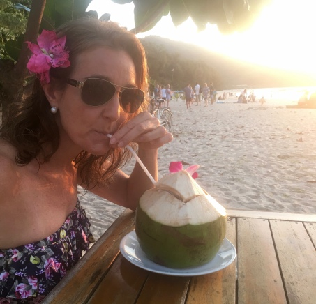 Sipping fresh coconut water on Nai Yang beach, Phuket