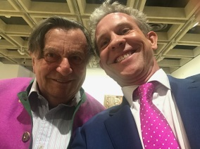 Comedian Barry Humphries and John Fison bonding over magenta